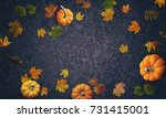 pumpkins and autumn leaves top... | Shutterstock . vector #731415001