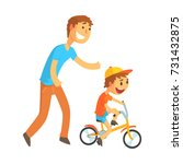 father teaching his son to ride ... | Shutterstock .eps vector #731432875