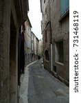 Small photo of idyllic narrow street in old town village in europe, alleyway