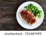 white rice topped with teriyaki ... | Shutterstock . vector #731487499