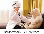 cute child playing doctor with...   Shutterstock . vector #731493925