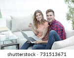 pair students with a laptop... | Shutterstock . vector #731513671