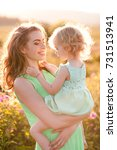 happy mother holding baby girl... | Shutterstock . vector #731513941