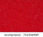 Small photo of Background macro texture of the banal red synthetic sponge for washing dishes