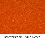Small photo of Background macro texture of the banal orange synthetic sponge for washing dishes