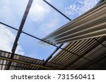 gray metal sheets roofing are... | Shutterstock . vector #731560411