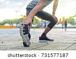 close up young sport man is... | Shutterstock . vector #731577187