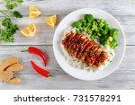 teriyaki chicken breast served... | Shutterstock . vector #731578291