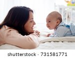 young mother  caressing her... | Shutterstock . vector #731581771