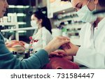 manicurists giving manicure to... | Shutterstock . vector #731584447