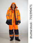 a man in overalls and work wear.... | Shutterstock . vector #731590471