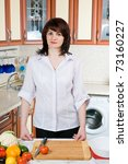 beautiful woman prepares food...