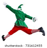 xmas time and green elf  | Shutterstock . vector #731612455
