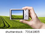 The Digital Camera In A Hand....