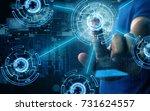 businessman press virtual screen | Shutterstock . vector #731624557