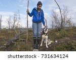 young hiking woman with happy... | Shutterstock . vector #731634124