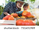 father teaching his son how to... | Shutterstock . vector #731651989