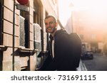 happy laughing young man  with... | Shutterstock . vector #731691115