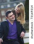 happy couple outdoor in a park   Shutterstock . vector #73169314
