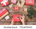packing christmas presents on... | Shutterstock . vector #731695441