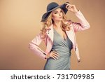 fashion blonde model in nice... | Shutterstock . vector #731709985