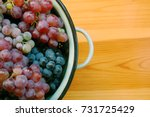 red and white grapes on wooden... | Shutterstock . vector #731725429