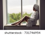 girl in a bathrobe and towel on ... | Shutterstock . vector #731746954