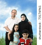 Muslim Arabic family of four members outdoor - stock photo