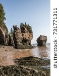 Small photo of The famous Hopewell Rocks geologigal formations at low tide biggest tidal wave Fundy Bay New Brunswick Canada