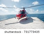 red helicopter on a floating... | Shutterstock . vector #731773435