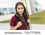 a nine years old girl student... | Shutterstock . vector #731777005