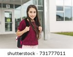 a nine years old girl student... | Shutterstock . vector #731777011