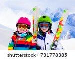 kids skiing in mountains.... | Shutterstock . vector #731778385