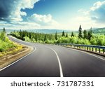 road in north mountain forest | Shutterstock . vector #731787331