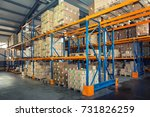 rows of shelves with boxes in... | Shutterstock . vector #731826259
