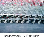 row of red shopping carts in...   Shutterstock . vector #731843845