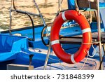red lifebuoy  fixed on deck of... | Shutterstock . vector #731848399