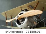 Sopwith Camel Biplane Propeller Machine Guns and Nose Cone in Museum Setting