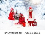 children with christmas tree on ... | Shutterstock . vector #731861611