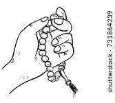 hand drawn hand holding islamic ... | Shutterstock .eps vector #731864239