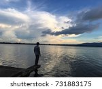 one young man standing alone on ... | Shutterstock . vector #731883175