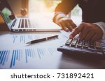 Small photo of business man financial inspector and secretary making report, calculating or checking balance. Internal Revenue Service inspector checking document. Audit concept.