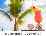 glass of fruit cocktail and... | Shutterstock . vector #731945434