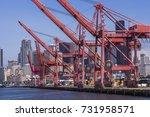 red cranes working in the port... | Shutterstock . vector #731958571