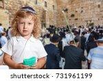 beauteous little boy with blue... | Shutterstock . vector #731961199