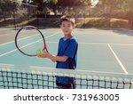 young tween asian boy tennis... | Shutterstock . vector #731963005