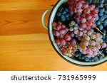 red and white grapes on wooden... | Shutterstock . vector #731965999