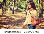 young  girl smiling in autumn... | Shutterstock . vector #731979751