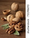 Walnuts with leaf on a wooden table. - stock photo