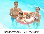 happy family with inflatable... | Shutterstock . vector #731990344